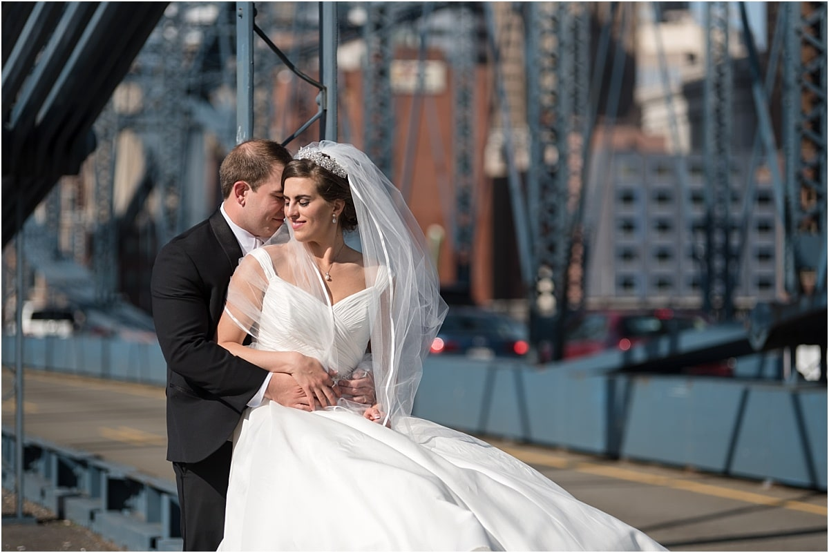 Bride and groom on the Smithfield Street bridge for pictures on the wedding day.