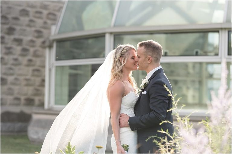 bride and groom in front of Phipps Conservatory.