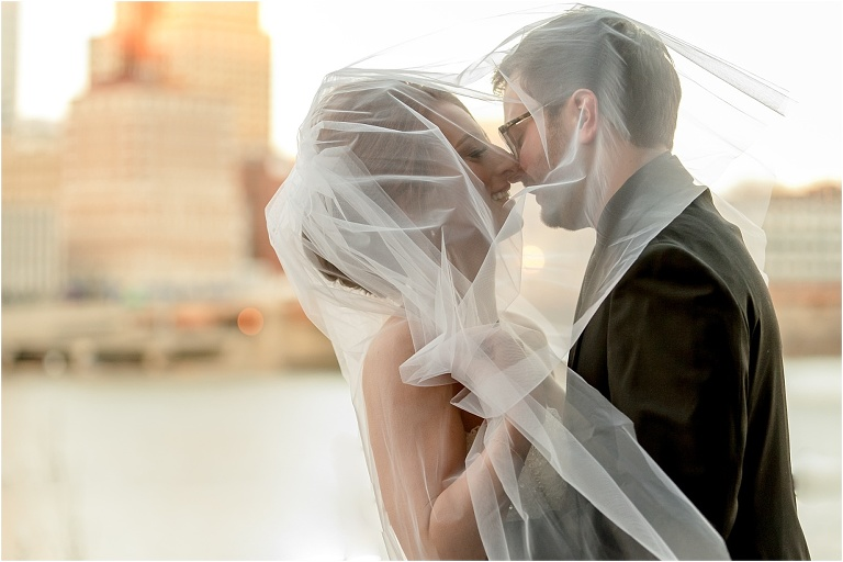 Bride and groom under veil at Pittsburgh Sheraton Station Square wedding.